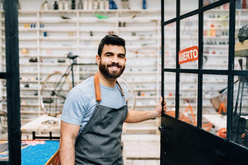 Bike shop owner opening workshop